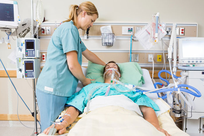 critical care nurse taking care of a patient patient care assistant duties