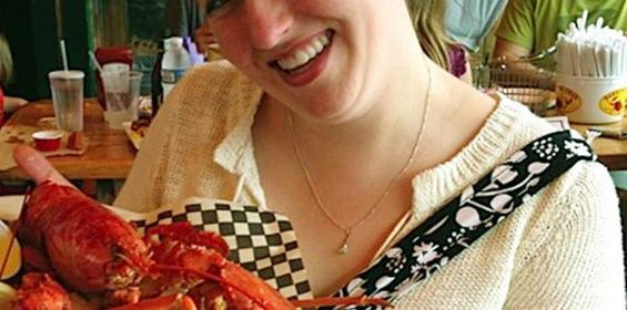 Lori eating lobster while working in Boston.