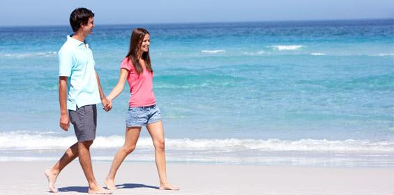 Couple walking on the beach in South Carolina